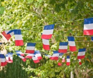 French flags garland decorating a village square